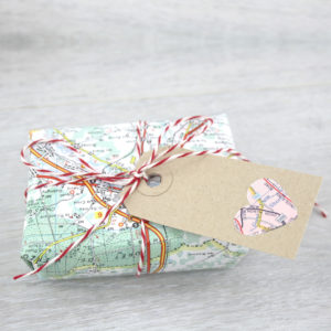 map and travel themed wrapping paper for six0six design