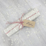 gift wrapped and add red bakers twine and a gift tag by six0six design