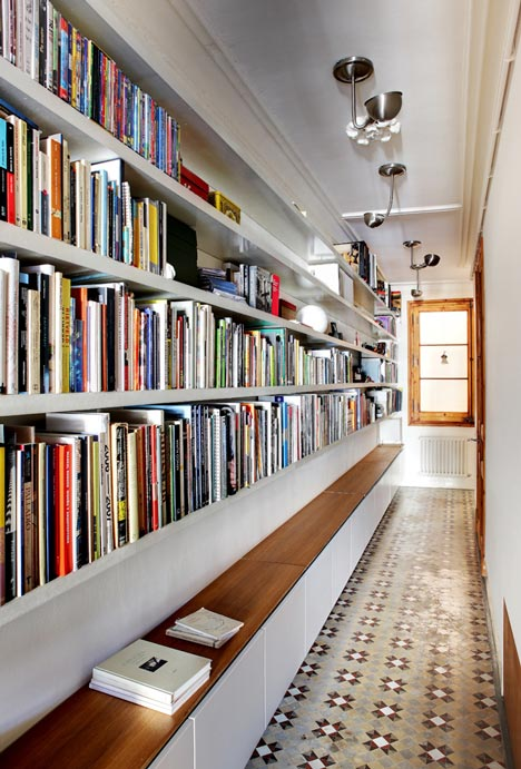book storage and seating bench along a corridor space